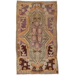 Antique Khotan Rug, Purple and Brown Outer Field, Green Borders, circa 1920s