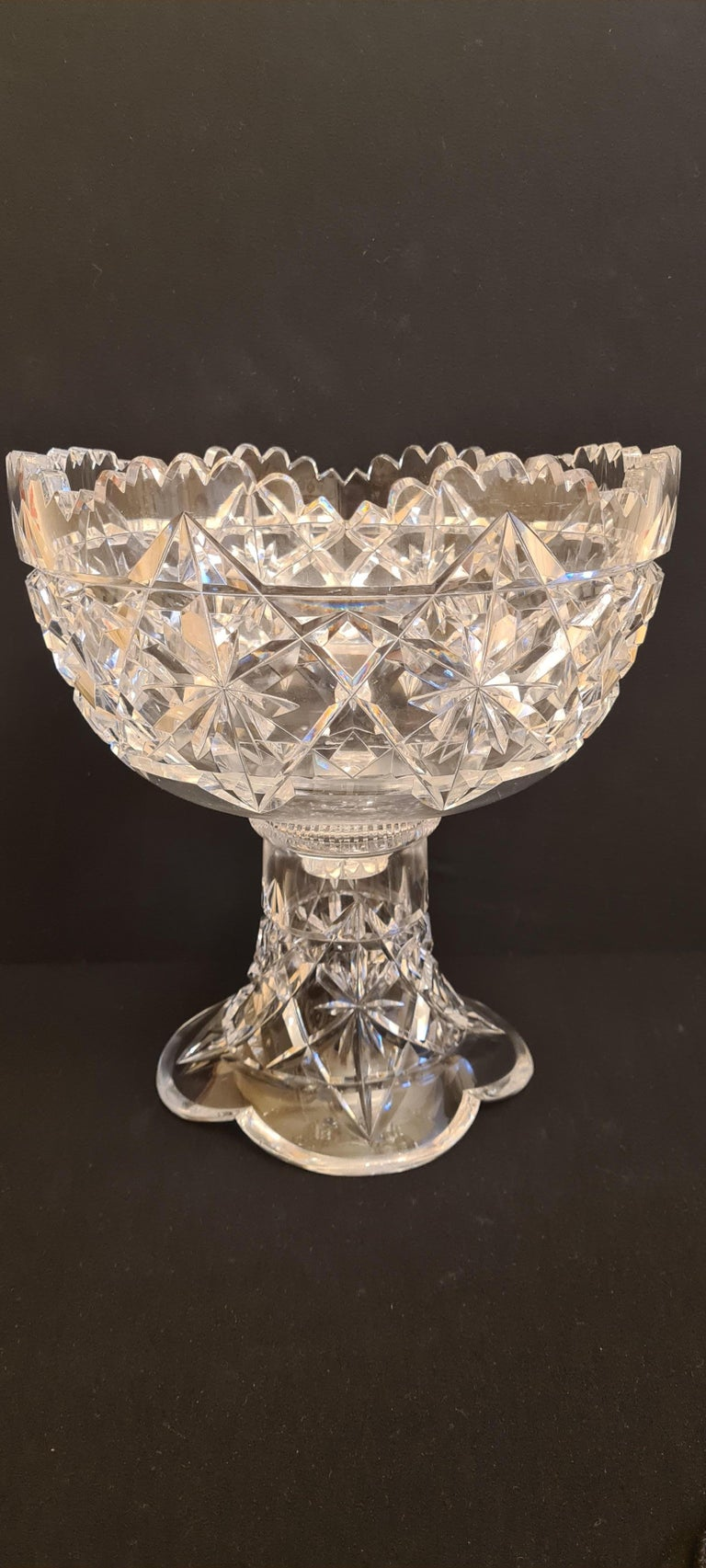 Amazing antique American Brilliant cut crystal punch bowl by Hawks & Co.; Years 1880-1900.  This cut crystal two piece punch bowl, stand and bowl by T.G. Hawkes & Co. exibits the brilliant kings pattern. The kings pattern is the rarest of the