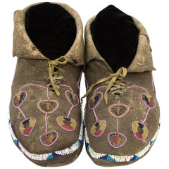 Antique Kiowa 'Plains Indian' Beaded Buffalo Hide Moccasins, circa 1850-1875