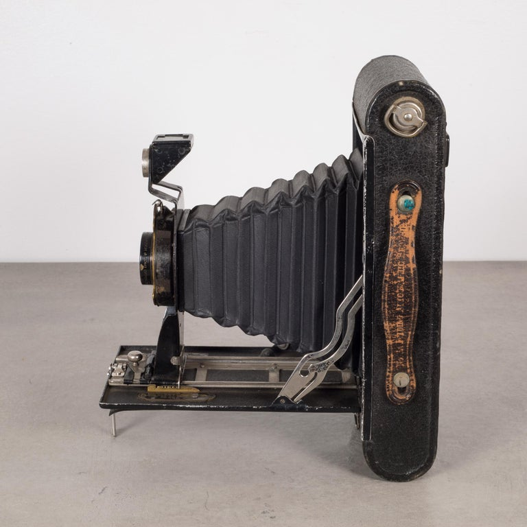 About  This is an original Eastman Kodak No. 3A folding camera. The body is wrapped in leather with chrome and brass accents. The camera features a hand-held shutter push button and folds to 2 inches. This piece has retained its original finish