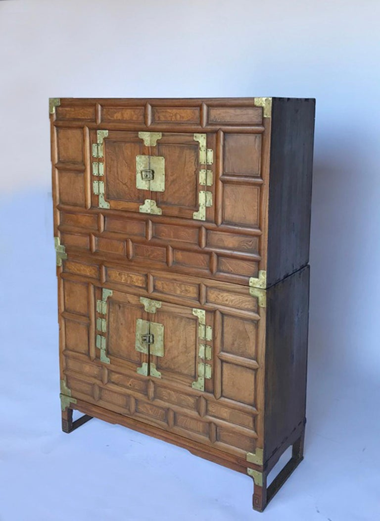 19th century double blanket chest on wooden base. All original brass metal work and hardware. Doors reveal open storage, see photos. Beautiful graining and patina on wood.