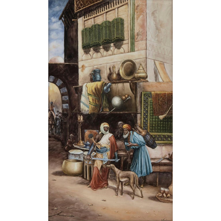 KPM style porcelain plaque of Orientalist Bazaar scene German, 20th century Measures: Frame: Height 78cm, width 53cm, depth 5cm Plaque: Height 60cm, width 35cm, depth 0.5cm  This finely executed porcelain plaque depicts a bustling bazaar, possibly