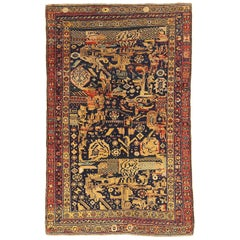 Antique Kurdish Rug of Persian Origin with Black and Yellow Tribal Patterns