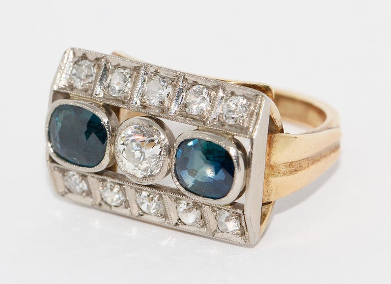 Antique ladies gold ring, with sapphires and diamonds.  The central diamond solitaire has about 0.4 carats.  US ring size about 6 1/2.  Including certificate of authenticity.