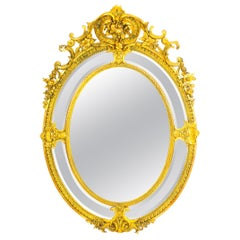 Antique Large Giltwood Louis Revival Oval Cushion Mirror, 19th Century