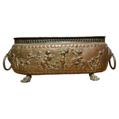 Antique Large Jardiniere / Planter Embossed with Putti Sculptures in Deep Relief