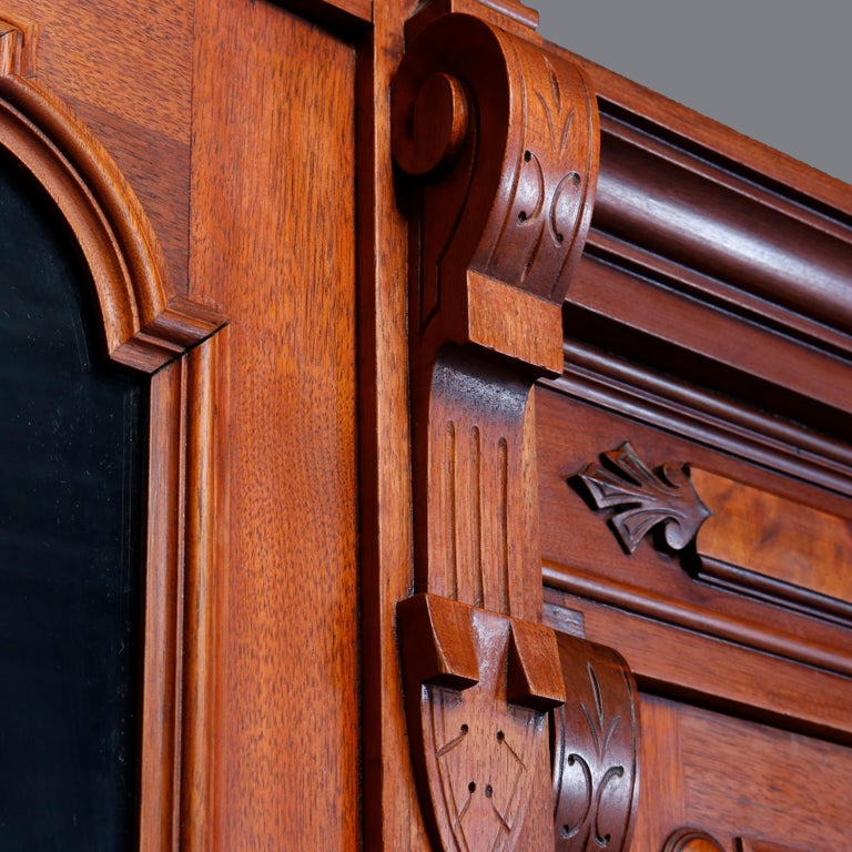 Eastlake Large Victorian Carved Walnut and Burl Enclosed 3-Section Bookcase, circa 1890