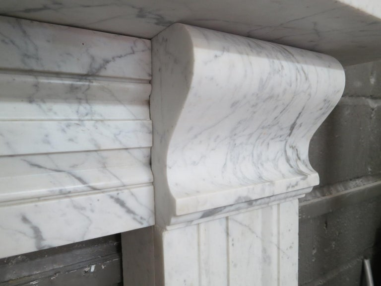 Carved Antique Late Regency Marble Fireplace Mantel For Sale