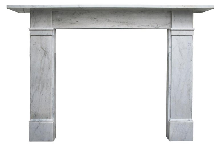 Antique late Victorian Carrara marble fireplace surround of simple unadorned form, circa 1890.