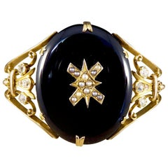 Antique Late Victorian Onyx, Pearl and Diamond Bangle in 15 Carat Yellow Gold