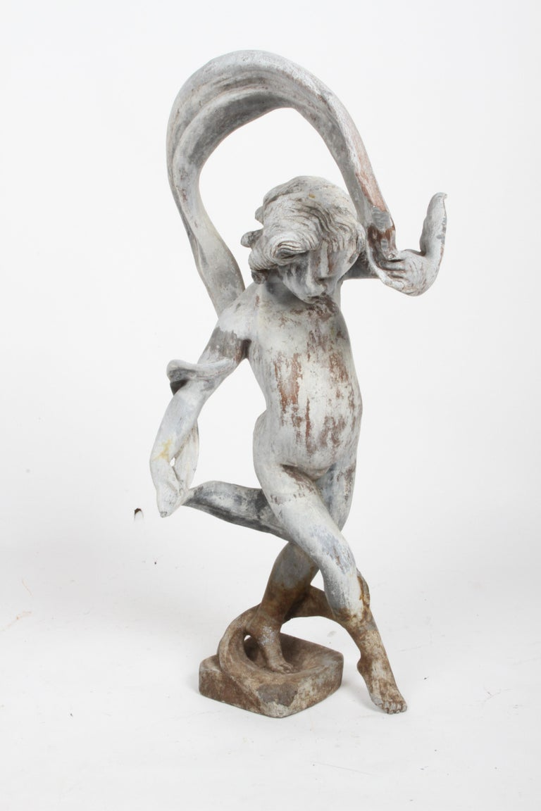 Rarely seen large antique lead garden sculpture of a dancing Putti or Cherub waving a ribbon. Nice patina to lead, some dirt or soil marks to base, few chew marks from critters and a slight opening on rear of leg. Overall shows very well, expected