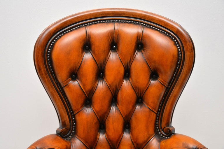 Mid-20th Century Antique Leather and Mahogany Spoon Back Armchair For Sale