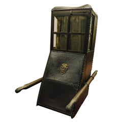 Antique leather sedan Chair, regal black leather and gilded brass, wooden '800