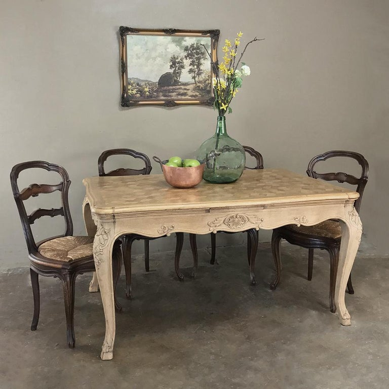 Antique country French Provincial stripped draw leaf dining table is a classic and ingenious design, with leaves ready for action with the pull of the ends straight out. Leaves just as easily tuck back in. The solid hand carved framework with