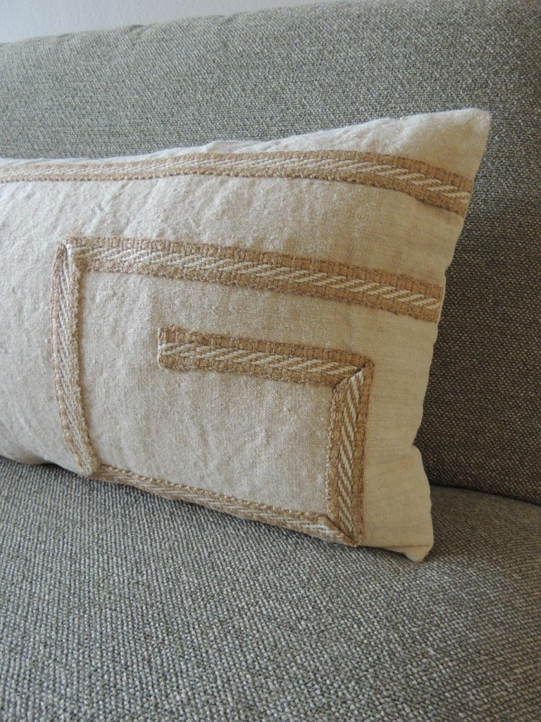 Antique linen decorative bolster pillow with vintage jute trim. Greek key pattern, Natural cotton backing. Decorative pillow handcrafted and designed in the USA. Closure by stitch (no zipper closure) with custom made pillow insert. Size: 13