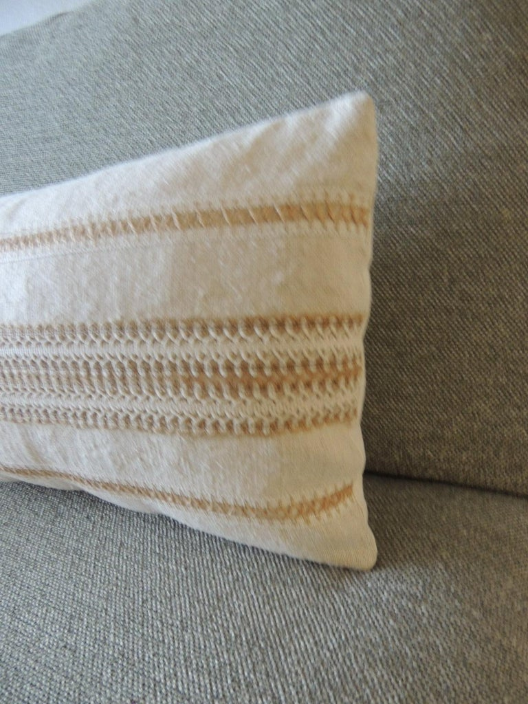 Antique linen decorative bolster pillow with vintage jute trim. Woven white and tan trim. Natural cotton backing. Decorative pillow handcrafted and designed in the USA. Closure by stitch (no zipper closure) with custom made pillow insert. Size: