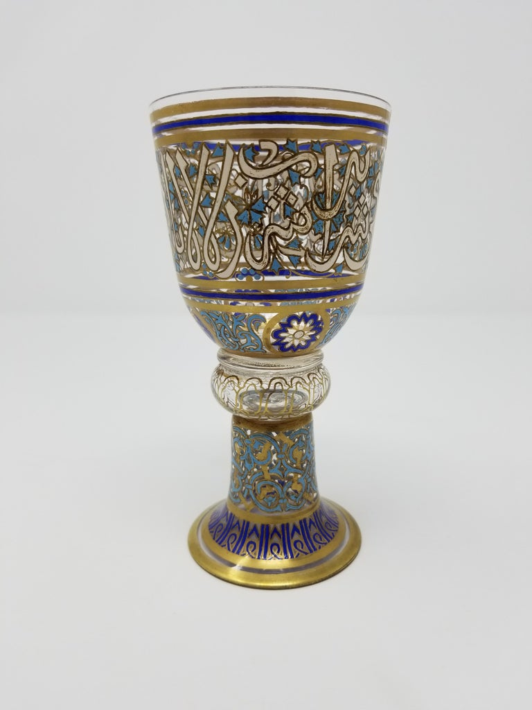 A magnificent antique Lobmeyr Islamic gilt and enameled glass goblet with Islamic calligraphy decoration, signed on the bottom by Lobmeyr. Most probably commissioned for the ottoman market. This goblet is magnificently enameled with cobalt blue,
