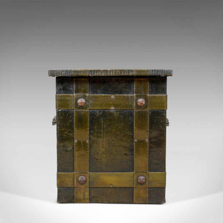 This is an antique log bin. An Edwardian, bound metal, fireside box with Arts & Crafts overtones dating to the early 20th century, circa 1910.