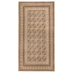 Antique Long and Narrow Oriental Khotan Rug. Size: 7 ft 8 in x 15 ft 1 in
