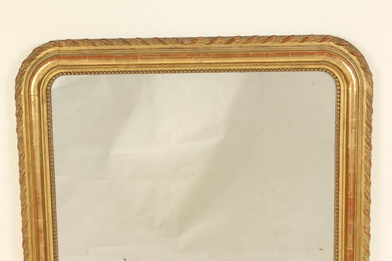 Antique Louis Phlippe style gilt wood mirror, late 19th century. Having original gilding and old diamond dust glass.
