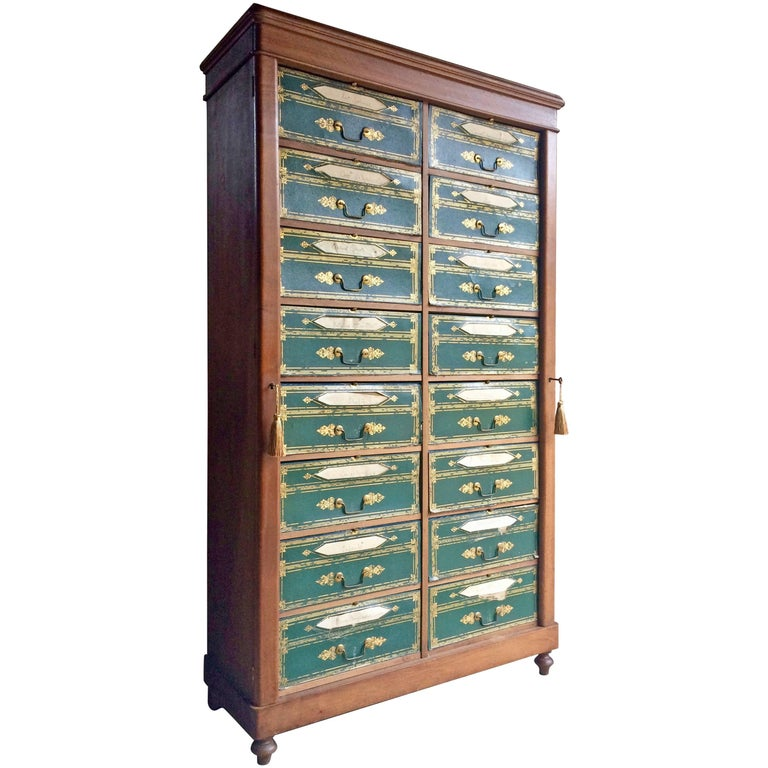 A magnificent Louis Phillipe mahogany and gilt tooled leatherette Cartonnier, circa 1840, of wellington type, incorporating 16 paper lined drawers, fronted by gilt tooled leatherette fronts incorporating title apertures, on a plinth base and turned
