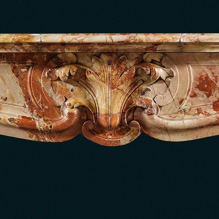 Carved Antique Louis XV Sarrancolin Fireplace Mantel For Sale