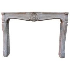 Antique Louis XV Style Limestone Fireplace