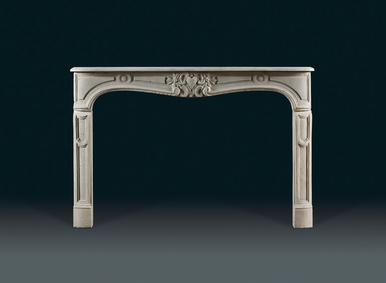 """With serpentine shelf and frieze, which is centred with a foxes' head surrounded by """"C"""" scrolls and flowering foliage, flanked by cartouches and circular paterae, 19th century."""