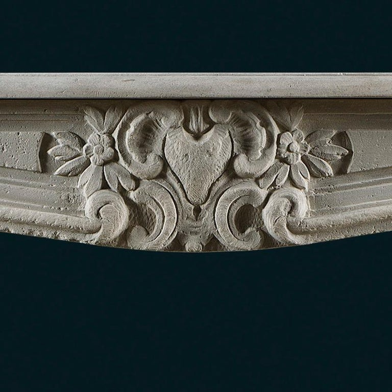 Carved Antique Louis XV Style Limestone Fireplace Mantel For Sale