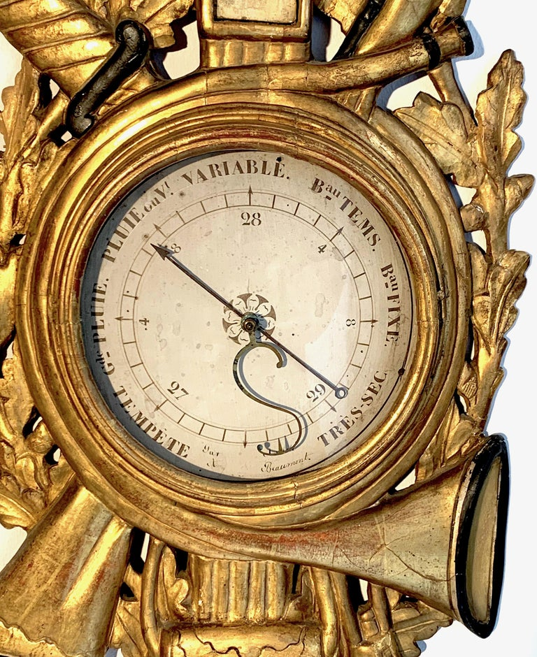 Extraordinary and rare Louis XVI barometer and thermometer carved exquisitely in beech wood circa 1775. This wonderful object ist beautifully carved, gilt and painted, it has been made for or presented to a passionate hunter.  The top part with the