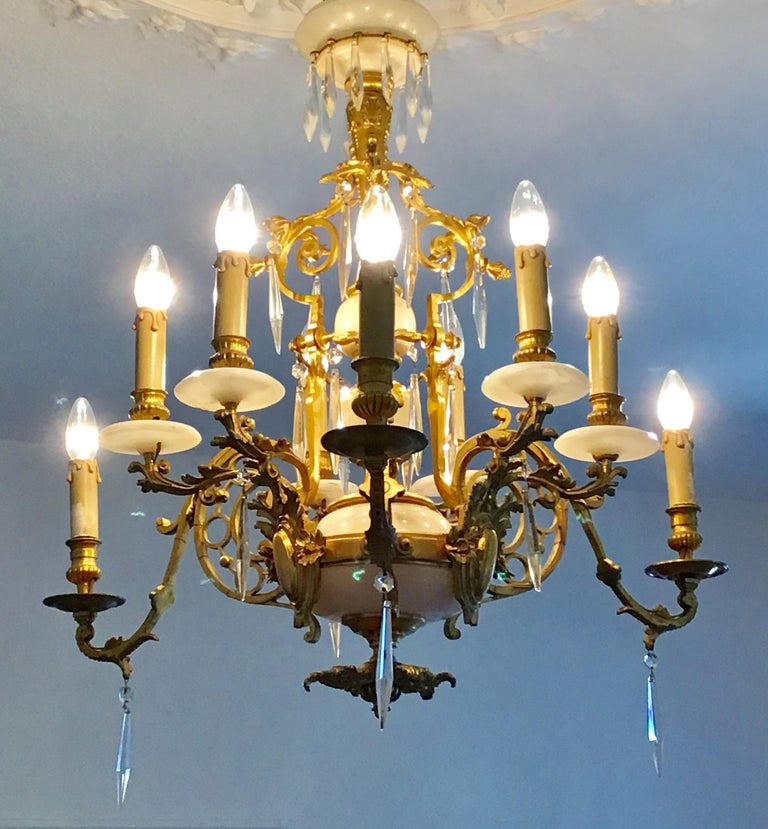 Antique, French, nine-light gilt bronze and marble chandelier in the style of Louis XVI, France circa 1850s-1880s.