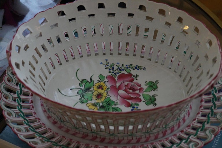 France, circa 1880.  LunevilleKeller et Guerin with their famousStrassbourg hand painted decor.  The basket is in very good condition, the under plate has some minor damage.  Measures: Basket 19 cm x 25 cm, 10 cm high Under plate 24 cm x 30