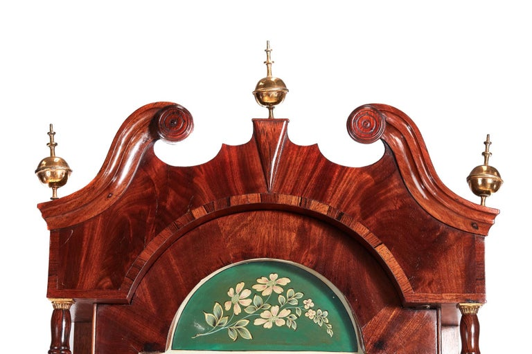 Outstanding antique mahogany 8 day painted face longcase clock signed Johnson Knaresboro with a swan-neck pediment with original brass finials. This a stunning piece, very decorative and colourful arched painted dial with a seconds dial. It has an 8