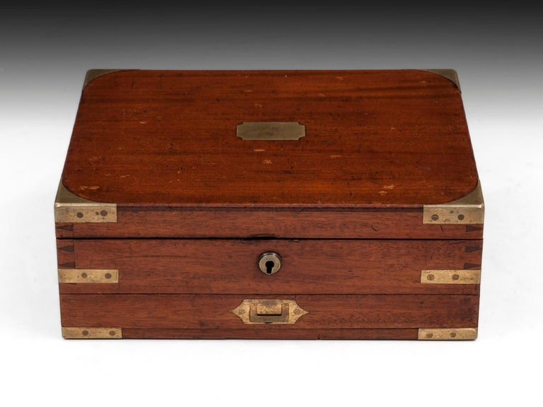 """Mahogany brass-cornered dovetailed Artist's box with flush Campaign handle to the front drawer. The underside of the lid has an embossed burgundy leather insert to the interior of the lid, stamped """"James Newman, 24 Soho Square, London"""". Fitted tray"""