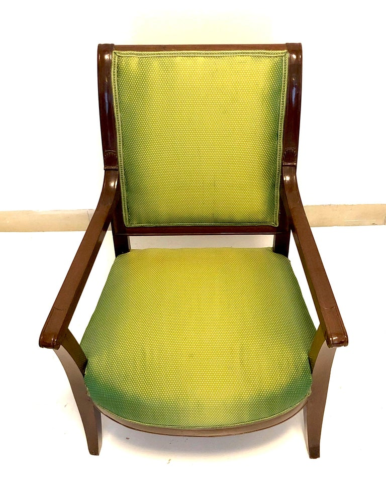 This charming children's armchair is made out of mahogany with fine carving. It is newly upholstered with a discretely patterned fine, lustrous fabric in green with golden spots. Paris, circa 1810, Empire.