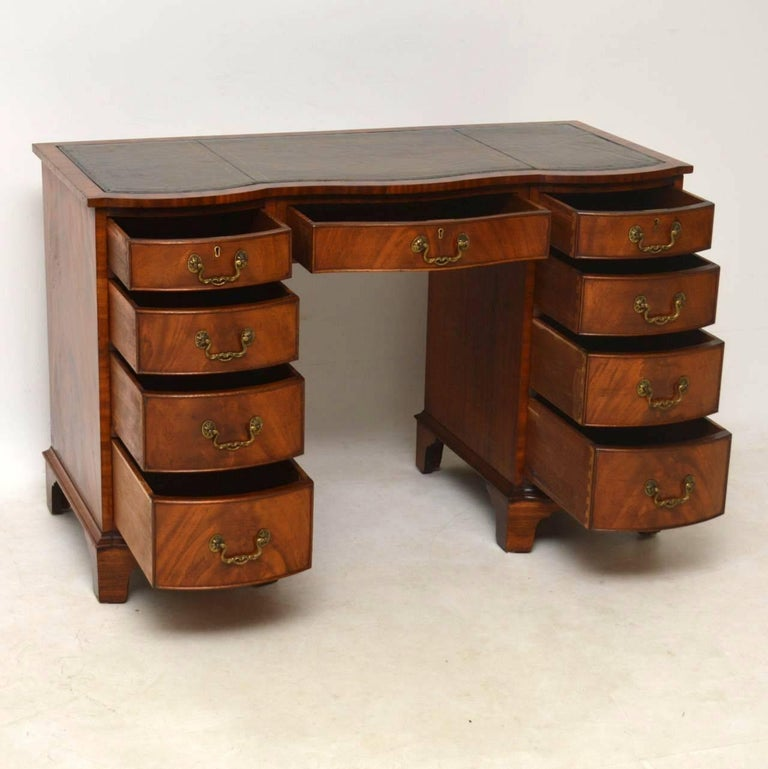 This antique mahogany serpentine fronted desk has small proportions, but  still has a generous sized - Antique Mahogany Leather Top Desk At 1stdibs