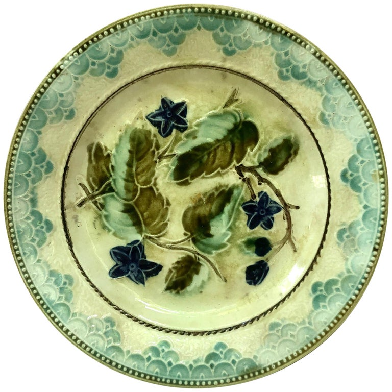 Majolica plate with blue flowers and leaves, circa 1890 attributed to Onnaing.