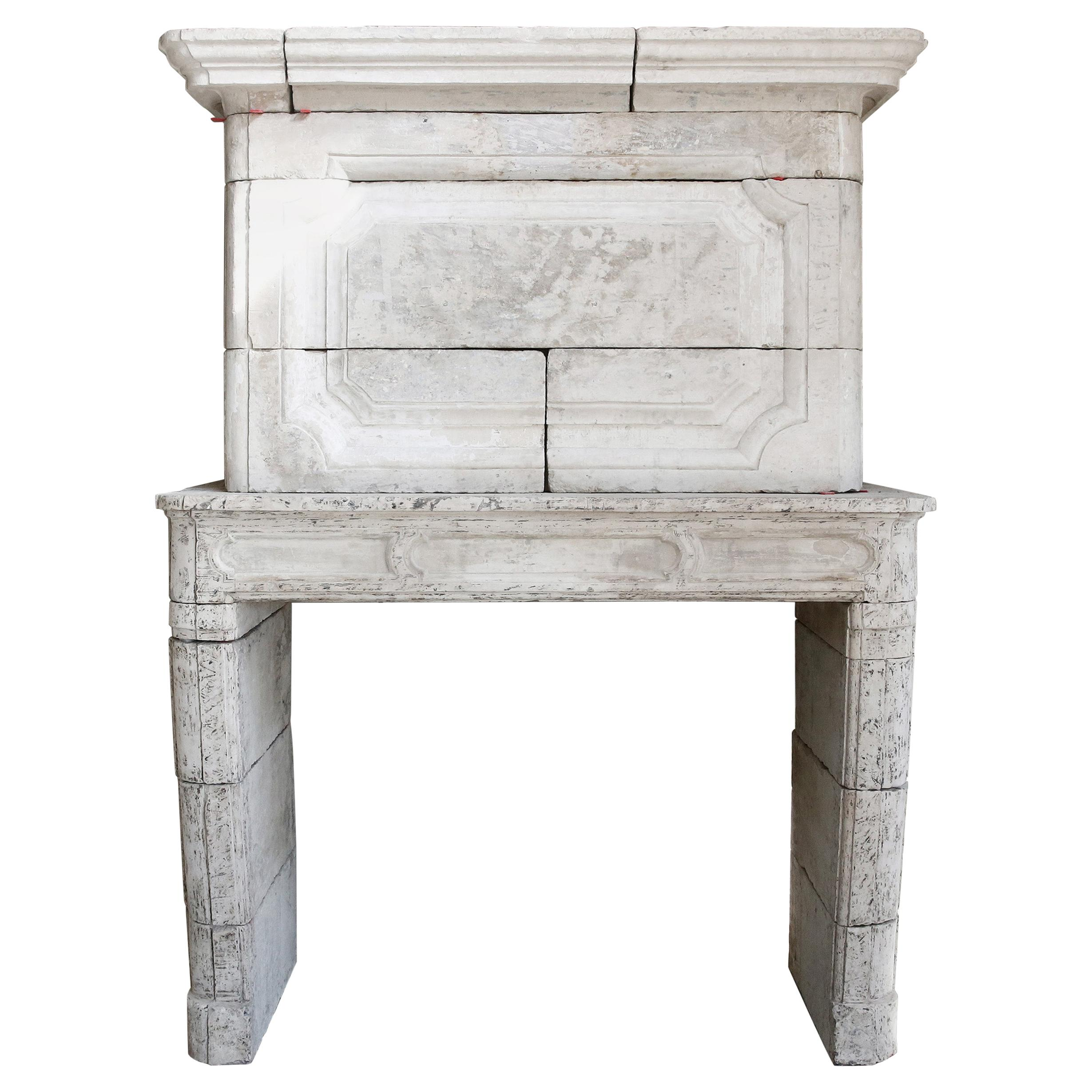 18th Century Mantel Surround of French Limestone with a Trumeau