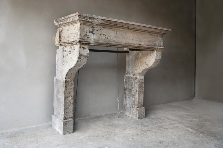 Tough antique chimney from the 19th century of French limestone. This old mantelpiece has a warm color nuance and patine and the moulure (frame) in this fireplace creates an authentic look. A beautiful fireplace that would fit very well in a country