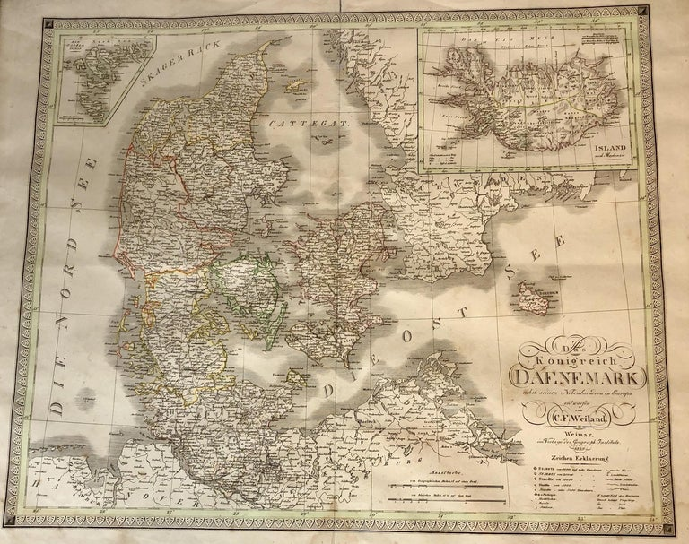 Antique map of Denmark in a black wooden frame and glass screen.