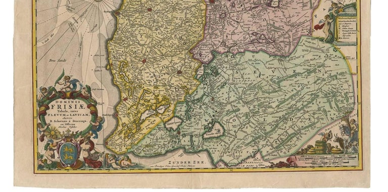 This large copper engraved map details the coastline of Friesland and Terschelling. At east is a part of Groningen. The main cities are colored in red. The very decorative cartouches displays putti and a coat of arms. At the right corner there is an