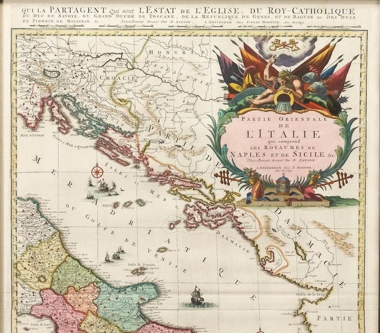 Presented is an original map of the Eastern Part of Italy, circa 1720. The map displays the kingdoms of Naples and Sicily, showing the southern half of Italy and much of the Balkans. The map labels the maker as