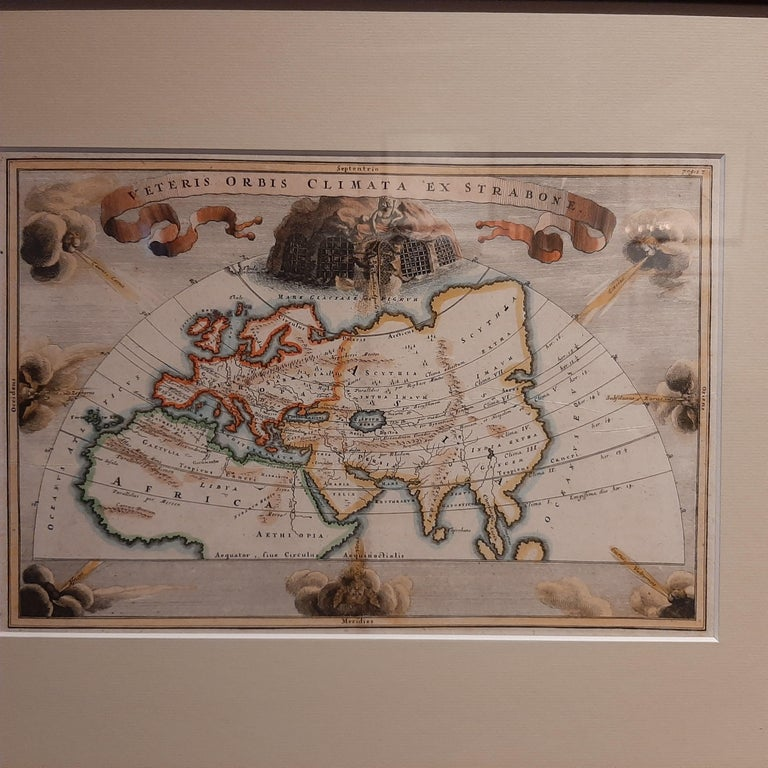 Antique map titled 'Veteris Orbis Climata ex Strabone'. Interesting map of the ancient world divided into seven climatic zones. The Asian continent is severely truncated and there is no Japan. The map is nicely composed in a semi-circular projection