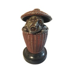 Antique Match Safe with Man Peeking Out of a Basket