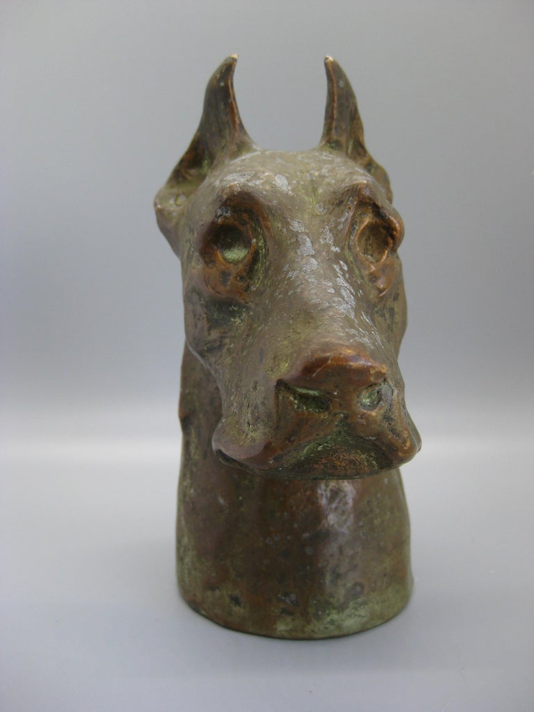 Antique hollow cast metal with a bronze finish Doberman Pinscher figurine/sculpture made by McClelland Barclay, circa 1920s-1930s. Signed on the back bottom edge. Great patina and color. Has some normal wear on the surface. The details are awesome