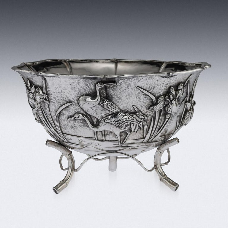 Antique early 20th century Japanese Meiji period solid silver bowl, double walled, chased and embossed with blossoming irises and cranes in high relief on matted ground, shaped floral rim applied with a pronounced boarder and standing on three