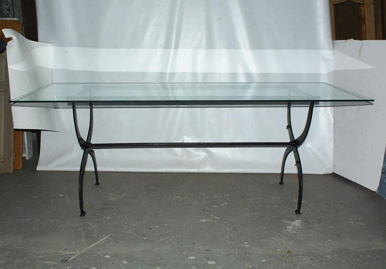 Rustic and elegant at the same time, this indoor or outdoor antique iron base is actually made from an old Dutch army cot base raised higher by adding additional stops and supports to table height. Top and base can be sold separately. The base can