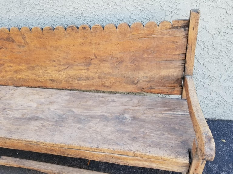 Stunning antique sabino pine bench, with scallop carved back, 19th century Mexican.