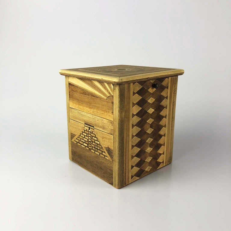 This antique cigarette dispenser is made of very small pieces of wood, when the top is opened the cigar is offered, it has a space where the cigars are stored, circa 1950.
