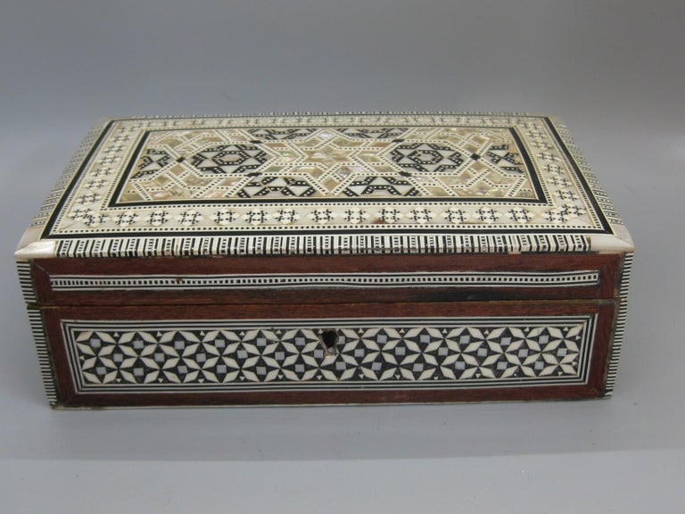 Beautiful highly detailed handcrafted micro mosaic marquetry wooden trinket/jewelry box. Pieces are made of mother of pearl and bone. High quality wood work and made very well. Inside is lined with red velvet. Measures approx. 7 3/4